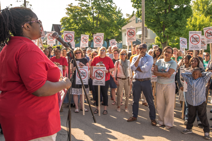 Auer Avenue educator Ingrid Henry-Walker speaks to over 400 parents, students, educators, and community members gathered to fight the takeover of MPS (photo credit: Joe Brusky).
