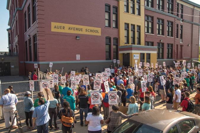 Hundreds showed up Auer Avenue Elementary for an action against the takeover.
