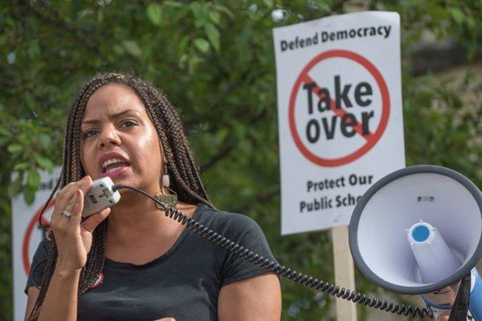 Jennifer Epps-Addison speaks to large gathering outside of Senator Aberta Darling's office.