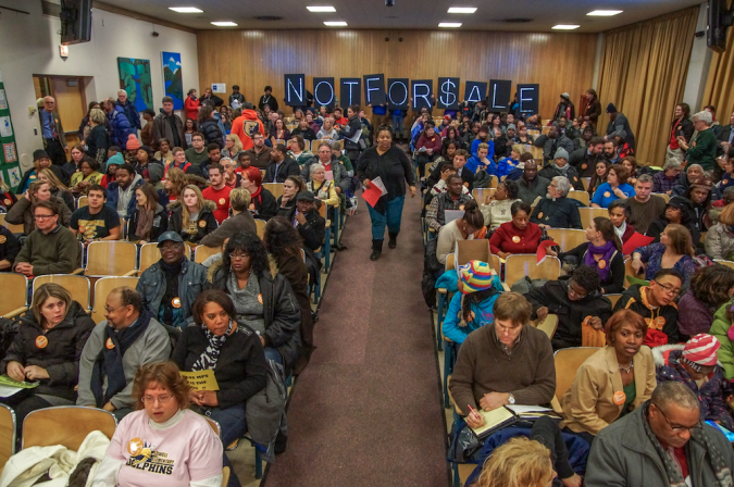 Milwaukee residents pack a school board meeting to say no to privately run charter schools (Photo credit: Joe Brusky).